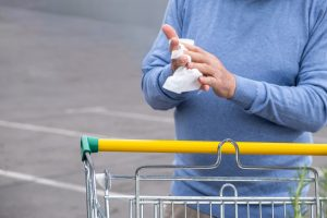 Cleaning hands at Supermarket